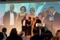 Wales Audit Office staff collecting the award